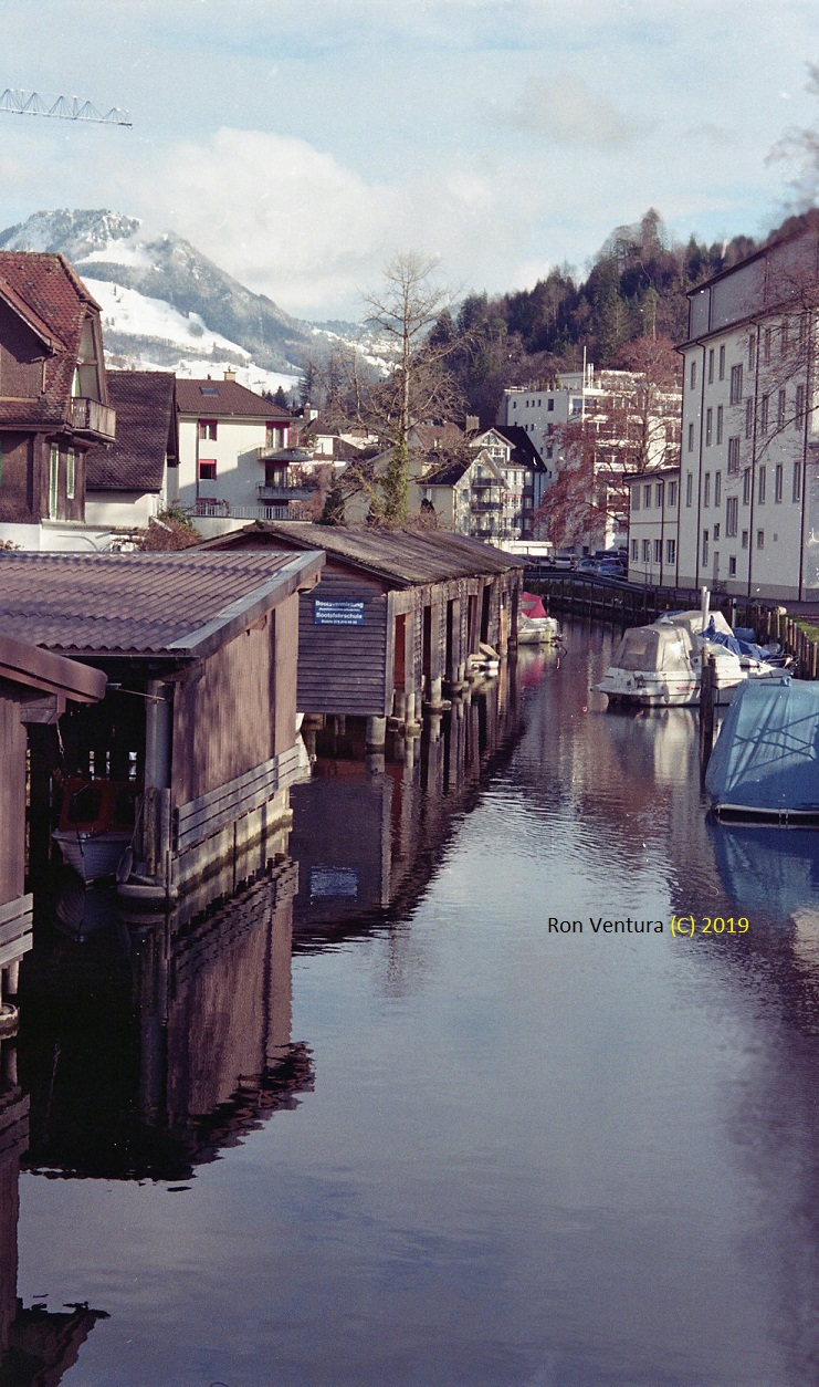 Winter Coming: Boats Docking in Canal Wooden Cabins and Outside